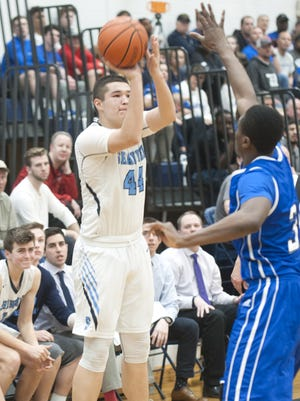 Shawnee's Dylan Deveney shoots in front of Williamstown's O.C. Uhuegho during the fourth quarter of Wednesday's South Jersey Group 4 quarterfinal playoff game.