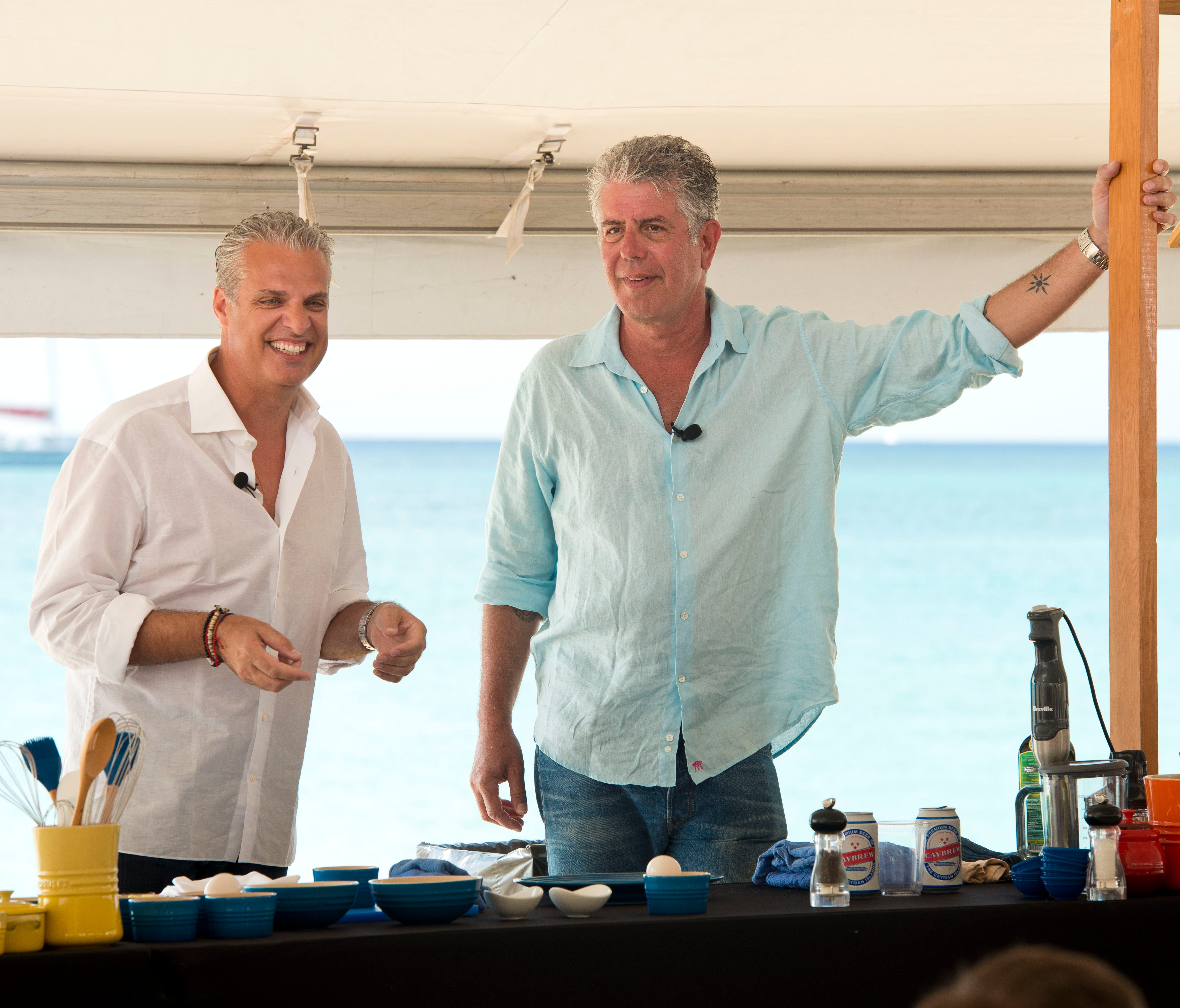 Chefs Anthony Bourdain (right) and Eric Ripert host a cooking demonstration at the annual Cayman Cookout festival.