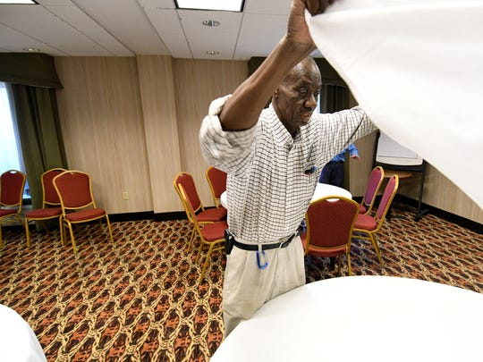 Fred Ipaye works maintenance but helps wherever he is needed, like setting up a room for a business meeting. Ipaye works at the Hampton Inn West Knoxville at Cedar Bluff on Executive Park Drive Friday, Oct. 6, 2017.