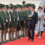 Japanese Prime Minister Shinzo Abe is welcomed by Bavarian riflemen after his arrival at the airport in Munich, Germany on Saturday, June 6, 2015,President Barack Obama departed Washington Saturday evening after delivering the funeral service for Vice President Joe Biden's son, Beau.