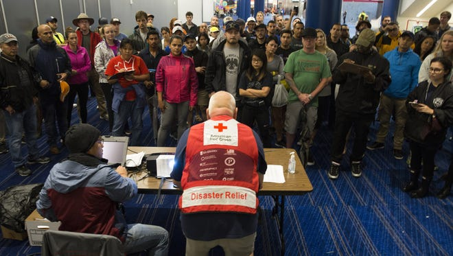 Hurricane volunteers are briefed at the George Brown Convention Center in Houston, which turned into an American Red Cross shelter after Hurricane Harvey tore through the Texas Gulf Coast in late August.