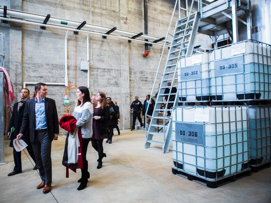 Board members with the Downtown Memphis Commission receive a tour of the new Old Dominick distillery with Helene Champ (red coat), marketing director at Old Dominick, at 305 S. Front on Thursday, Jan. 26, 2017.