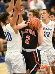 Central York's Garrett Markey pushes past the Falcons'