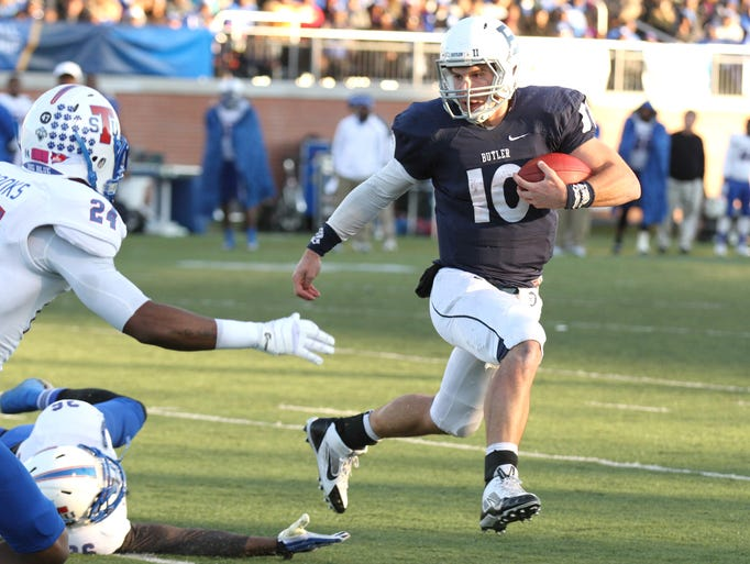 Butler quarterback Matt Lancaster carries the ball against Tennessee State Saturday November 30, 2013 at Butler. Tennessee State won 31-0.