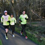 Marathon Runners who are memebrs of the Morristown-based Garmin Runners running group will be running in the Boston Marathon Left to right Alex Fowlie, Joanna Stevens, and Terry Davidson. Thursday 4/17/14 photo by Ed Pagliarini MOR 0417 Local Marathon Runners