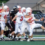 FILE - Titus McCoy, right, of Center Grove celebrates with his team after scoring what appeared to be a TD on an onsides kick recovery. Center Grove did not get the TD but they got the ball where it was recovered. Warren Central hosts Center Grove in high school football Aug. 23, 2013.