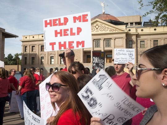Teachers participate in a #RedForEd protest March 21, 2018, at the Arizona state Capital.