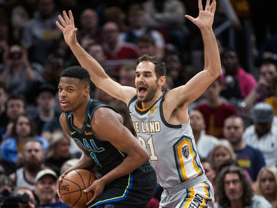Cleveland Cavaliers' Jose Calderon (81) guards Dallas Mavericks' Dennis Smith Jr. (1) during the second half of an NBA basketball game in Cleveland, Sunday, April 1, 2018. The Cavaliers won 98-87. (AP Photo/Phil Long)