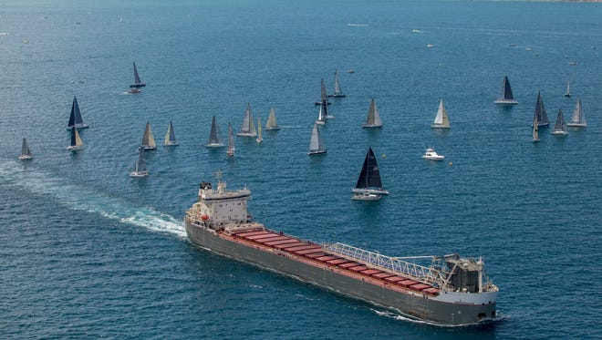 The freighter Manitoulin passes boats during the start of the Port Huron-to-Mackinac Island Sailboat Race Saturday, July 16, 2016 on Lake Huron.