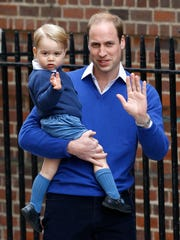 Prince William carries son George into St. Mary's Hospital