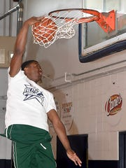 Tammrick Thomas participates in the dunk contest at