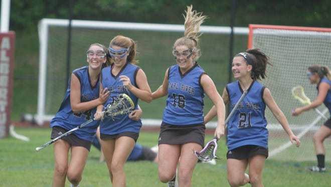 Pearl River players celebrate after defeating Albertus Magnus 6-5 in a Section 1, Class C semifinal game at Albertus Magnus High School on Monday, May 23rd, 2016.