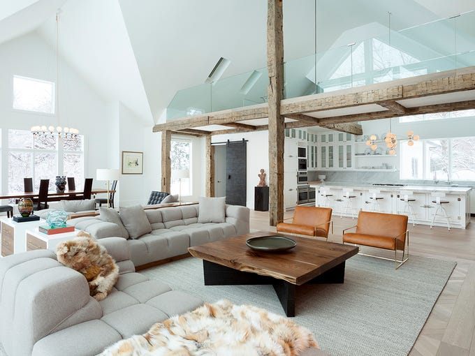 In the Great Room, hand-hewn reclaimed barwood beams
