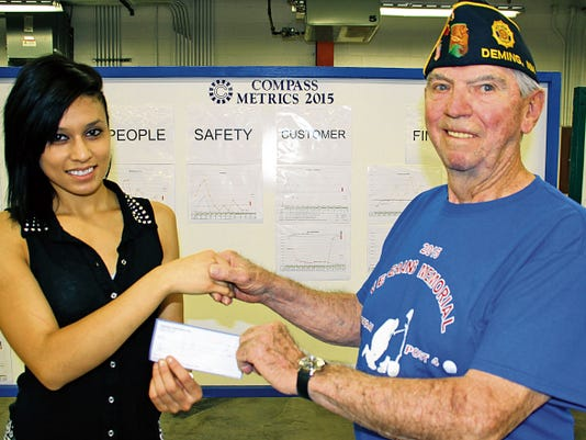 Bill Armendariz — Headlight Photo   Compass Manufacturing Employee of the Month, Rocio Bejarano, presented American Legion Bataan Post 4 Commander Nick Kirchen with a check for 1,000 to help the post with its Veterans Outreach program. Kirchen said the money will be used to help local veterans in the community and expand on the outreach's future projects. Compass Components Manufacturing is located at 2400 Atlantic Way in Deming's Industrial Park and employs 120. The Bataan Post 4 is also hosting a fund-raising golf tournament Saturday at the Rio Mimbres Golf Course and a Memorial Day ceremony at 10 a.m. on Monday at the Mountain View Cemetery flag pole.