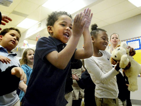 Hannah Penn kindergarteners Sy'vier Ford, left, and Ki'Asjah Woods dance to an education song in a class taught by Ashley White, right, Tuesday, March 24, 2015. Bill Kalina - bkalina@yorkdispatch.com