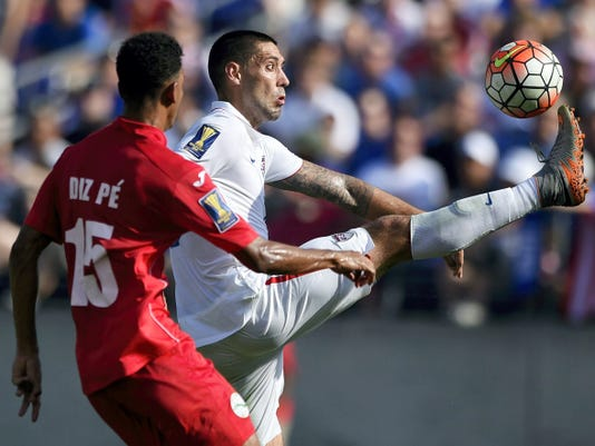 United States forward Clint Dempsey, right, kicks the ball against Cuba's Adrian Diz Pe (15) during the first half of Saturday's CONCACAF Gold Cup soccer quarterfinal match in Baltimore. The U.S. won, 6-0, behind a hat trick from Dempsey.