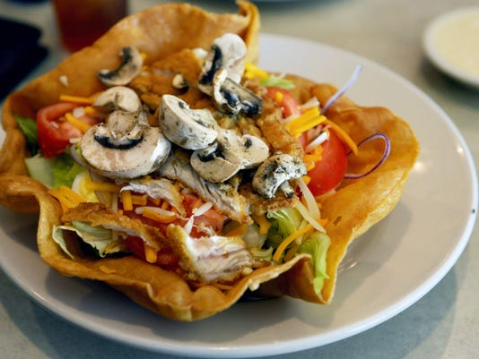 The crispy fried chicken salad at Lion's Pride Restaurant is served in a fried taco shell bowl, as pictured May 22. Lion's Pride Restaurant, in Dairyland Square in York Township, is a family-friendly restaurant with sit-down service.