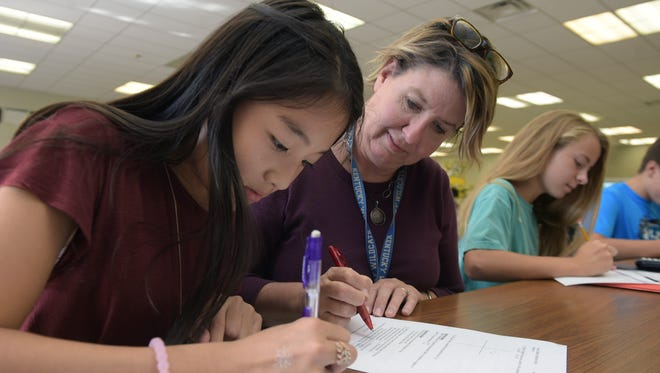 Brentwood Middle School student Rina Xu and teacher Holly Jones works together in the school cafeteria during focus class on Wednesday, Oct. 19, 2016.  The school has won two Blue Ribbon titles in 10 years.