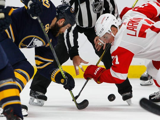 Buffalo Sabres' Ryan O'Reilly and Detroit Red Wings' Dylan Larkin take the face-off during the first period Tuesday, Oct. 24, 2017 in Buffalo, N.Y.
