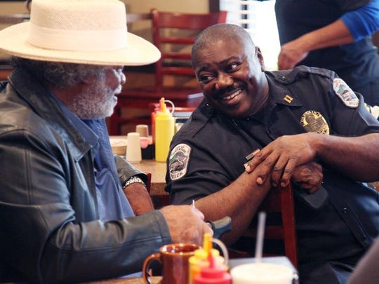 Capt. Melvin Perry, of the Fort Myers Police Department, has coffee with Robert Owens, of Fort Myers, during the Coffee with a Cop event at Utopia Soul Food Cafe on Wednesday.