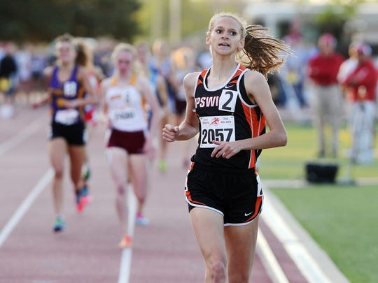 """Macy Heinz of Ipswich wins the girls 800-meter run special event Friday at the Howard Wood Dakota Relays. The sophomore calls the 800 """"probably my best race because I'm kind of a mix between a distance runner and a sprinter."""" Her time was 2:11.19."""