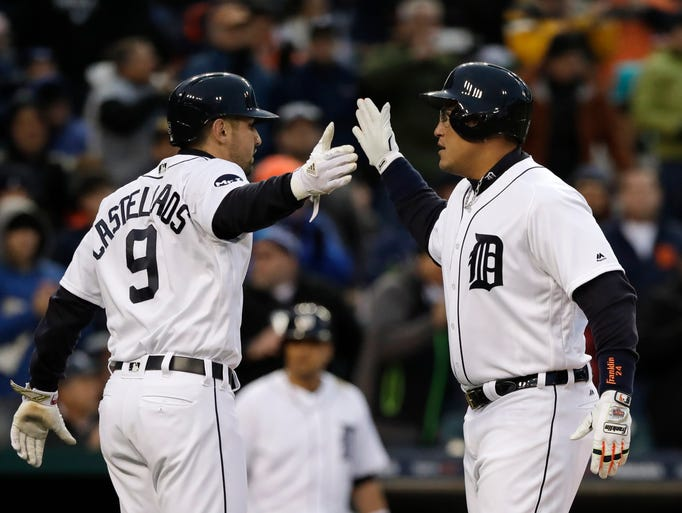 Tigers' Miguel Cabrera, right, is congratulated by