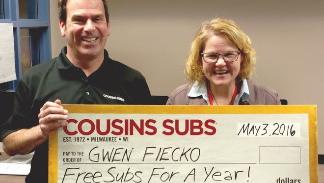 In honor of Teacher Appreciation Week, Cousins Subs of Manitowoc franchise owner Mike Smith, left, recently surprised Manitowoc Lincoln High School English teacher Gwen Fiecko with Cousins Subs for a year as part of the Cousins Subs Teachers Make It Better Contest. Fiecko was honored as a result of her positive impact on her students, school and community.