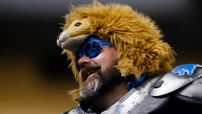 Detroit Lions fan Earl Spring in the stands against the Denver Broncos at Ford Field in Detroit, Sunday, Sept. 27, 2015.