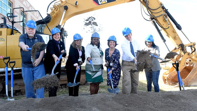 Members of the Washoe County School Board and superintendent Traci Davis, center, shovel dirt during the groundbreaking ceremony for the new expansion at Damonte Ranch High School in Reno last month.