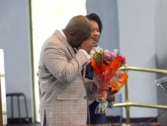 Pastor Christopher McCoy tears up as he is honored