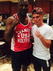 Chaise Nelson with former world heavyweight boxing champ Evander Holyfield at the Probox Management headquarters in Miami.