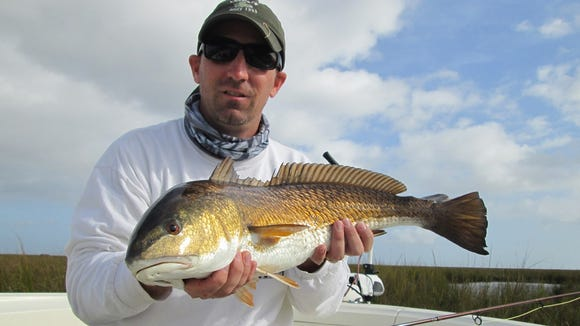 Kevin Ruefly found fly fishing to be very productive in the marshes while fishing with Sonny Schindler of Shore Thing Charters.