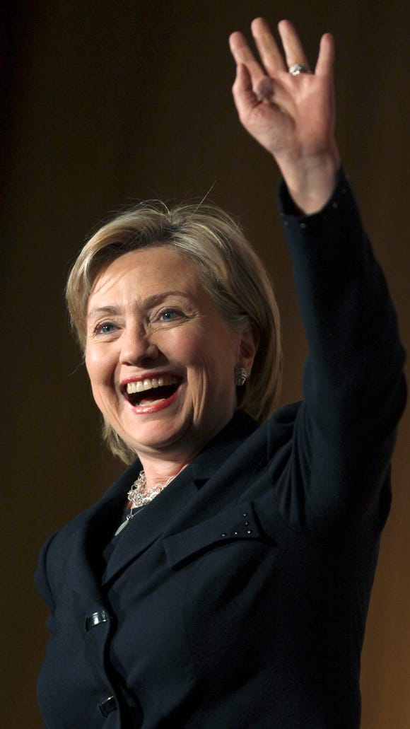 Hillary Clinton waves during a 2009 luncheon for the