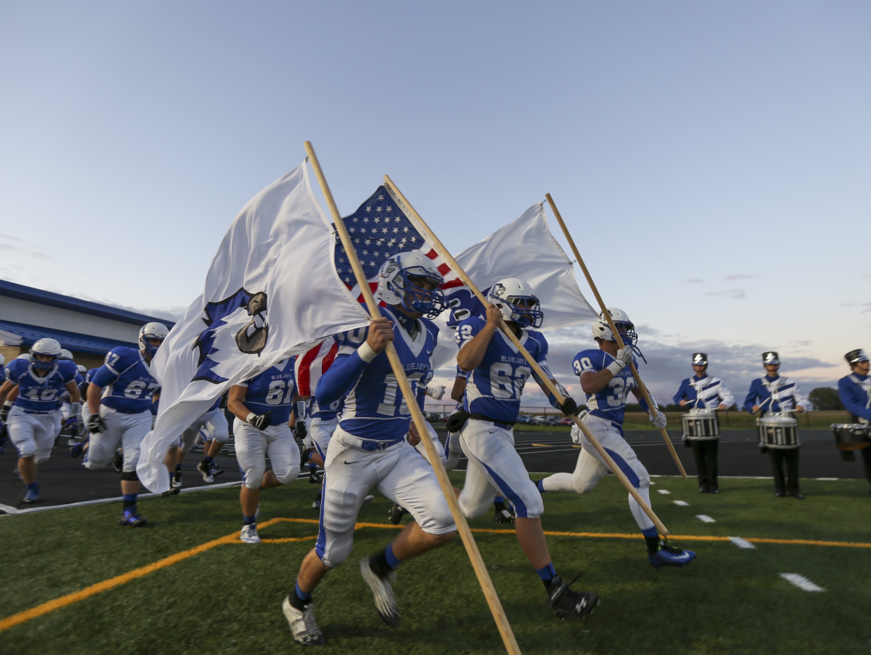 Bondurant-Farrar players take the field before a high school football game against Nevada this past fall..