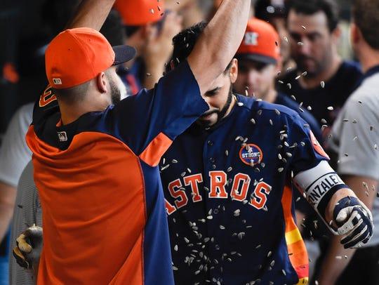 Houston Astros' Lance McCullers Jr., left, showers