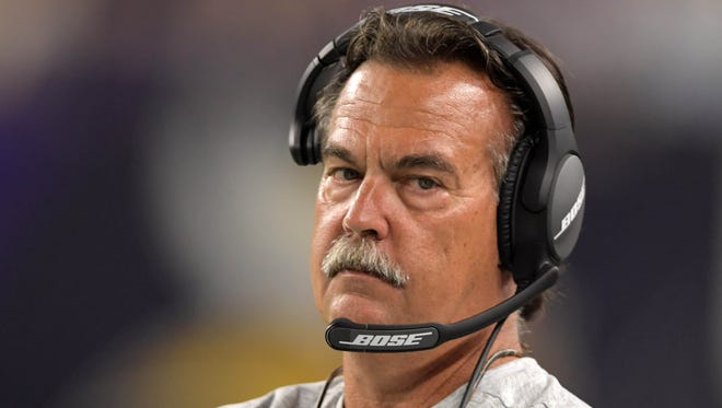 Los Angeles Rams coach Jeff Fisher reacts during a NFL game against the Minnesota Vikings at U.S. Bank Stadium.