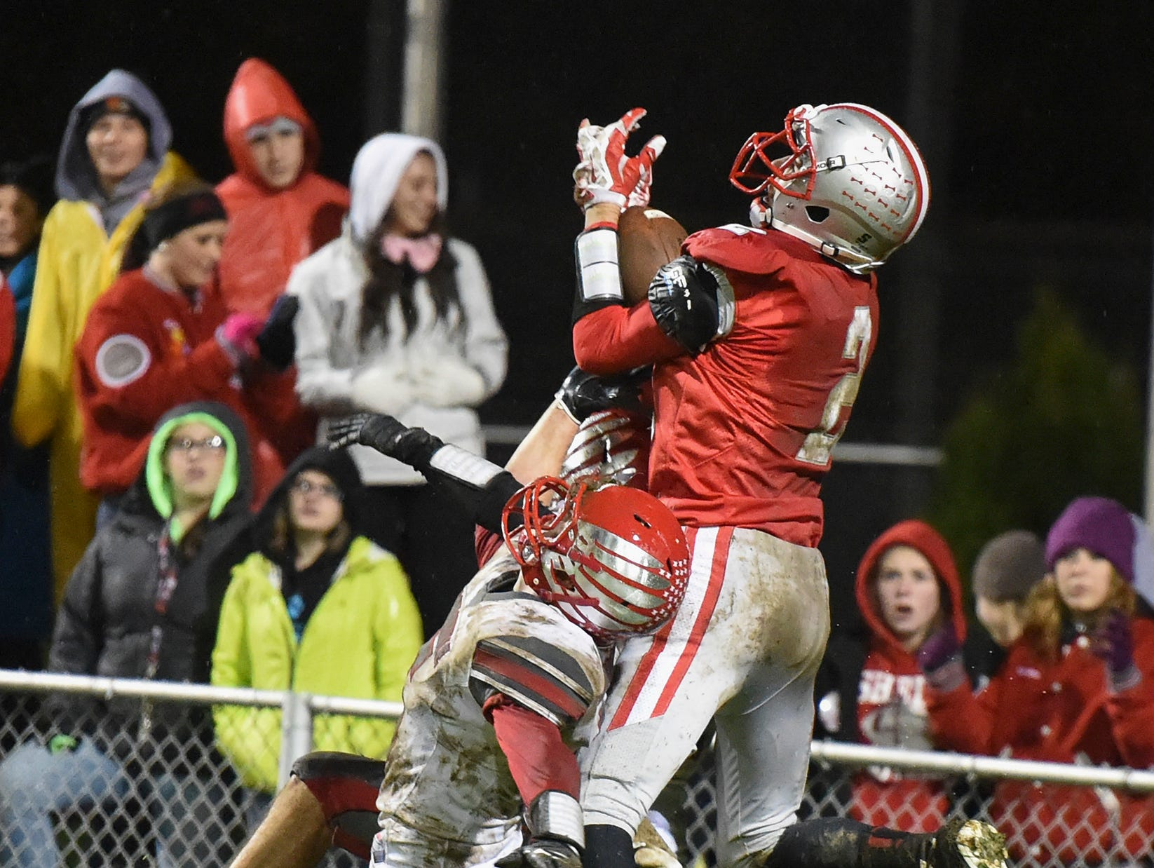 Shelby receiver Cody Stine, a record-setting high jumper, goes up for a pass last fall against Loudonville. Stine will play for the North all-stars.