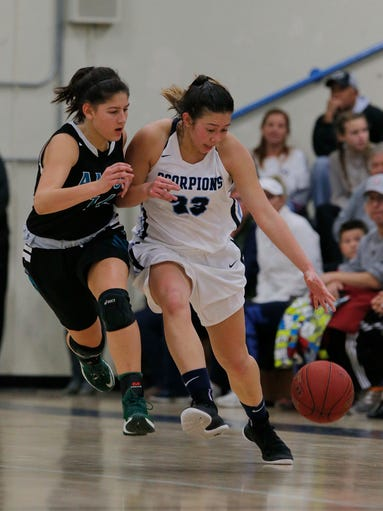 Camarillo's Madeline Weight tries to get away from