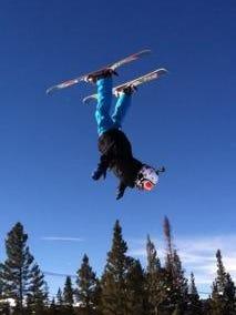 Chris Conradi in Colorado doing a flip in mid air.