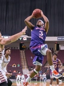 NSU's Devonte Hall, who prepped at Bossier High, scores 2 of his 11 points against ULM Saturday at the CenturyLink Center.