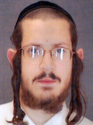 """Yoel Oberlander in 2007, when he was arrested by the Town of Ramapo Police Department Special Services Division for violation of the """"Rockland County pedophile-free safety zone act."""""""