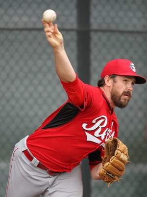 Reds pitcher Sam LeCure throws in the bullpen at spring training on March 1.
