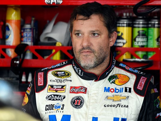 FILE - In this Sept. 13, 2014, file photo, NASCAR driver Tony Stewart (14) looks out from his garage during a practice for the NASCAR Sprint Cup Series auto race at Chicagoland Speedway in Joliet, Ill. An upstate New York grand jury has finished hearing testimony regarding Tony Stewart's role in the on-track death of sprint car driver Kevin Ward. The Ontario County District Attorney will announce the findings at 3 p.m. Eastern Wednesday, Sept. 24, 2014. (AP Photo/Paul J. Bergstrom, File)