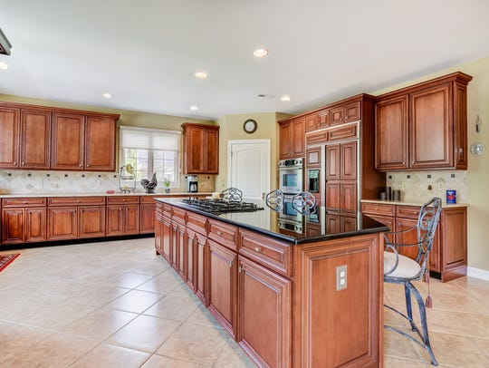 The Chef's kitchen offers a granite center island and