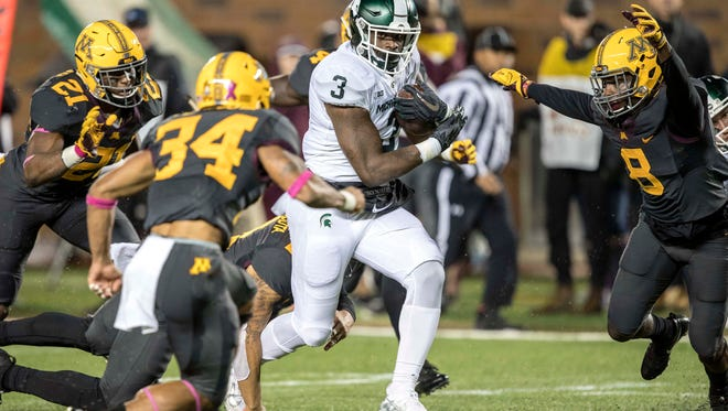 Michigan State junior running back LJ Scott averaged nearly 8 yards per carry Saturday. His late fumble, though, was a reminder of why it's hard to completely trust him.