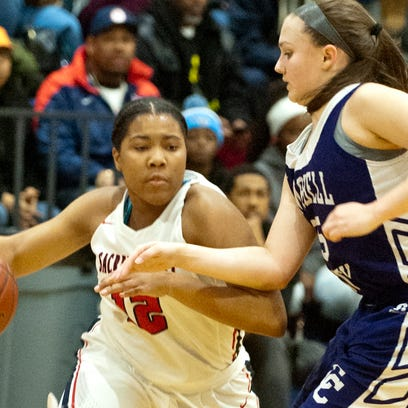 Sacred Heart guard Erin Toller drives around Campbell