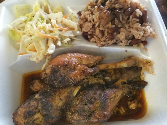 Smiling Flavors Caribbean Jerk's chicken is all leg meat.The three mildly spicy and subtly sweet legs were accompanied by a fragrant coconut rice studded with pinto beans and served with a crunchy coleslaw.
