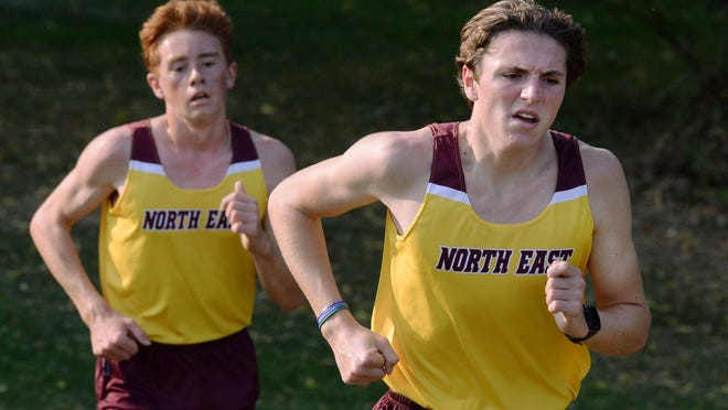 North East High School runners Lucas Boyd, left, and Brock Pennington lead a cross country race with Harbor Creek High School on Thursday in North East.