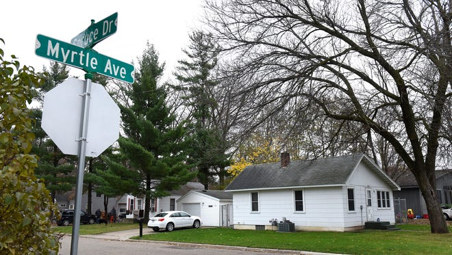 The house at 55 Myrtle Ave Thursday afternoon in Annandale. Officials say Daniel James Heinrich, 52, was arrested after a search of the residence revealed child pornography.