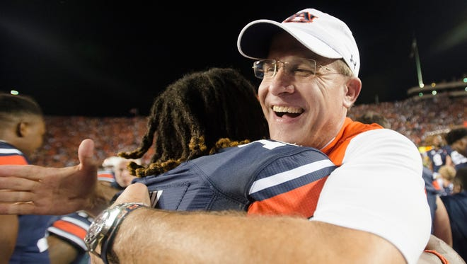 Auburn head coach Gus Malzahn celebrates with Auburn defensive back Markell Boston (11) after Auburn defeated LSU 18-13 as time expired in the NCAA football game between Auburn and LSU Saturday, Sept. 24, 2016, at Jordan Hare Stadium in Auburn, Ala.